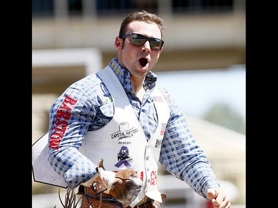 Mason Clements from Santaquin, UT, riding Paradise Moon wins the Bareback event on day 7 of the 2017 Calgary Stampede rodeo on Thursday July 13, 2017. DARREN MAKOWICHUK/Postmedia Network