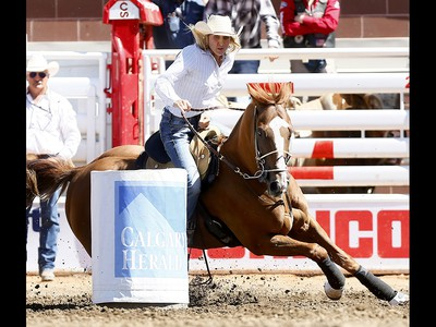 Tiany Schuster from Krum, TX, the Ladies Barrel Racing event on day 6 of the 2017 Calgary Stampede rodeo on Thursday July 13, 2017. DARREN MAKOWICHUK/Postmedia Network