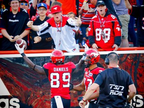 Calgary Stampeders receiver DaVaris Daniels celebrates after his touchdown with teammate Juwan Brescacin against the Toronto Argonauts during CFL football on Saturday, August 26, 2017. Al Charest/Postmedia
