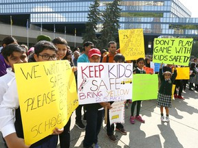 Over 100 parents and kids upset with the Calgary Board of Education's (CBE) new busing policy held a rally in front of Calgary City Hall on Tuesday August 15, 2017. Darren Makowichuk/Postmedia