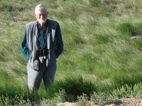 Gus Yaki viewing a prairie rattlesnake near the Onefour Heritage Rangeland Natural Area (photo credit Ann Lawson)