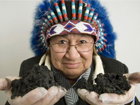 Chief Al Lameman of the Beaver Lake Cree Nation holds some oilsands.