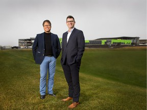 Chito Pabustan and David Wittman, recently appointed partners at Gibbs Gage Architects, stand in front of the Seton Recreation Facility and High School that the firm designed. Supplied photo, Sept. 2017, for David Parker column. Jason_Dziver-(403)870-2086