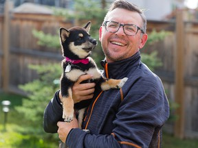 Former Flame Theo Fleury poses with his new dog, Kokoro, at his Calgary home.