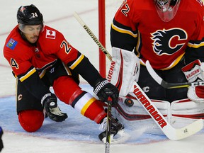 Calgary Flames defenceman Travis Hamonic and goaltender Jon Gillies keep the puck out of the net after a shot by Drake Gaggiula of the Edmonton Oilers during NHL pre-season hockey at the Scotiabank Saddledome in Calgary on Monday, September 18, 2017. Al Charest/Postmedia