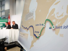 TransCanada President and Chief Executive Officer Russ Girling, right, and Trans Canada's President of Energy and Oil Pipelines Alex Pourbaix speak at their company's announcement of an Energy East Pipeline project on August 1, 2013.