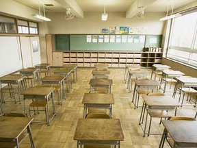 Chairs and desks in a classroom.