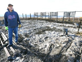 Marlon Many Guns shows what remains of his barn in Gleichen, Alberta south of Calgary.Wednesday, October 18, 2017.A wildfire raced through the reserve on Tuesday night, destroying, property and animals were burned alive. Jim Wells/Postmedia