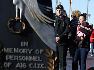 Calgarians pay their respects at the cenotaph during Remembrance Day ceremonies at the Military Museums in Calgary on  Saturday November 11, 2017.