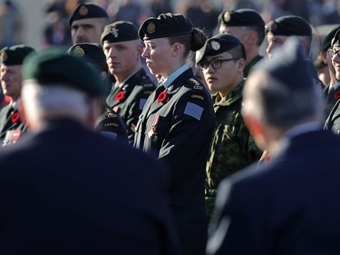 Veterans in the foreground and current armed forces members pay their respects at the cenotaph during Remembrance Day ceremonies at the Military Museums in Calgary on  Saturday November 11, 2017.