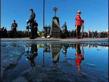 The honour guard stands at the cenotaph during the Remembrance Day wreath laying ceremony at the Military Museums in Calgary on  Saturday November 11, 2017.