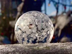 It's cold enough outside to make ice bubbles. Calgary photographer Chris Ratzlaff spent part of Boxing Day outside, freezing and photographing bubbles. A bubble in the process of freezing is seen in this Dec. 26, 2017, handout image. THE CANADIAN PRESS/HO-Chris Ratzlaff, *MANDATORY CREDIT*