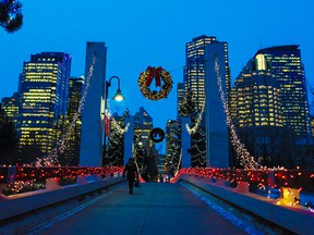 Calgarians commute into downtown through Prince's Island and Christmas lights.
