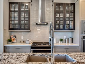 A look over the island in the kitchen of the Porter show home by Trico Homes in Legacy.