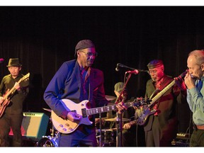 Charlie Butler, in front on guitar, leads his band, Charlie B and the Groove Crew.