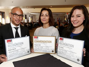 Award recipients L-R, Shaun Marcia, Margaret Bell and Kim Fisher with their certificates during the Beyond the Call, Calgary Fire Department Recognition Awards Luncheon at Fort Calgary. The awards recognize exceptional acts by citizens and emergency service personnal, both on and off-duty on Wednesday February 21, 2018. Darren Makowichuk/Postmedia