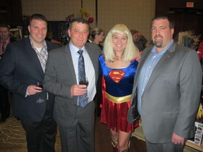 Cal 0512 Summit 9 The 14th Annual Super Gala for Cystic Fibrosis held Apr 27 at the Hyatt Regency Calgary was a great success and raised more than $70,000 for cystic fibrosis research being done at the U of C, Cumming School of Medicine, Snyder Institute for Chronic Diseases. Pictured, from left, are Delcor Construction's Marco Delcorno, Louie Delcorno, gala chair and CF advocate/45 year survivor Nicki Perkins and Mario Delcorno.