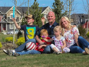 Alisa and Ray Piraux with their children Maddox, Quinton, and Emerson in the Cochrane community of Fireside by La Vita Land.