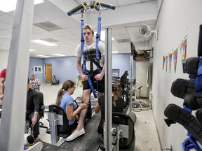 Ryan Straschnitzki on the Therastride machine at Shriners Hospital for Children in Philadelphia on Tuesday June 26, 2018.  Itís a body weight-supported manual treadmill training system that allows people with paralysis to walk. Leah Hennel/Postmedia