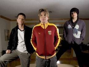 The Goo Goo Dolls  - (from left to right) drummer Mike Malinin, singer-guitarist John Rzeznik and bassist Robby Takac - pose for the Sun at a Toronto hotel yesterday.n/a