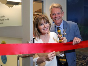 Founders Dr. Shelley Spaner and the Calgary Herald's Bill Brooks get ready for the ribbon cutting at the new Men's Health Clinic at the Rockyview Hospital in Calgary on Wednesday June 6, 2018.