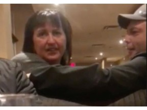 Screen grabs of Kelly Pocha, the B.C. woman caught on camera in the middle of a racist tirade to a table of brown-skinned men sitting behind her at the Denny's in Lethbridge.