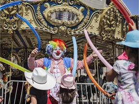Doo Doo the Clown entertains a group of children at the Calgary Stampede on Monday, July 9, 2018. Doo Doo (real name Shane Farberman) is back at the Calgary Stampede for the 20th year in a row.KerianneSproule/Postmedia