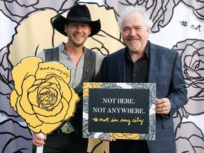 Pictured at the Not in My City 2nd annual VIP awareness and fundraising event held at the Deane House June 20 are #NotInMyCity founder Paul Brandt  with Michael Hayward, vice-president, marketing and guest experience at The Calgary Airport Authority. The Calgary Airport Authority announced its full support as an Ally of #NotInMyCity at a press conference held earlier in the day.