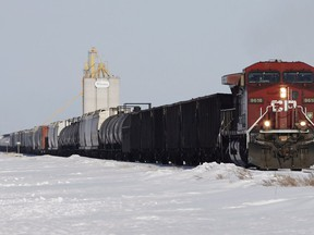 A CP Rail locomotive hauls grain and oil cars. The Alberta government has announced it is buying more rail cars to move oil out of the province.