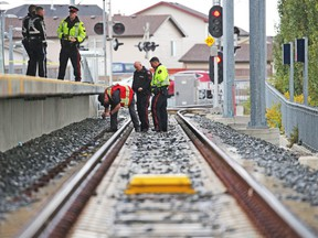 Police investigate the scene where a pedestrian was hit by a CTrain at the Saddletowne Station in northeast Calgary on Tuesday September 11, 2018.  Gavin Young/Postmedia