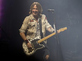 Country music singer Keith Urban performs at the Saddledome in Calgary on Sunday, Sept. 23, 2018.
