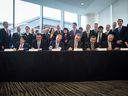 Executives from Royal Dutch Shell Plc and its international partners sign a final investment declaration to build the LNG Canada export facility in Kitimat, B.C., on Tuesday, Oct. 2, 2018.