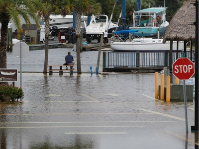 High tide from offshore Hurricane Michael creeps up into the Sponge Docks in Tarpon Springs, Fla., Wednesday, Oct. 10, 2018 after the Anclote River backs up. (Jim Damaske/The Tampa Bay Times via AP) ORG XMIT: FLPET101