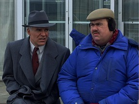 Comic actor John Candy, co-star with Steve Martin in Planes, Trains and Automobiles, would be perfect for a role in the farce involving Alberta's energy situation, says columnist Chris Nelson.
