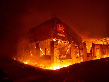 A Jack In The Box restaurant burns as the Camp fire tears through Paradise, north of Sacramento, Calif., on Nov. 08, 2018. More than 100 homes, a hospital, a Safeway store and scores of other structures have burned in the area.