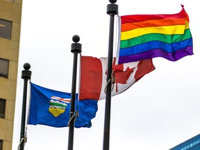 The Pride flag flies with the Canadian and Alberta flags after a flag raising to celebrate Pride Week outside the McDougall Centre in Calgary on Monday August 27, 2013.  Gavin Young/Postmedia
