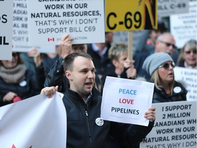 Protesters rally against Bill C-69 in downtown Calgary on Nov. 27, 2018, before Finance Minister Bill Morneau was to speak at the Telus Convention Centre.