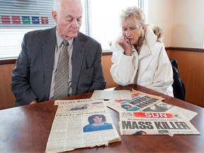 Former Reform MP Art Hanger, left, sits with Darlene Boyd and goes through old newspaper clippings in Okotoks on Monday, Nov. 12, 2018. Boyd's daughter Laurie was abducted and murdered in the town in 1982.