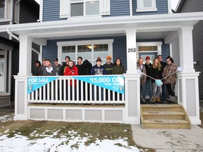 Jack James students celebrate the finished home they worked on with Homes by Avi.