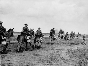 FILE-The horrors of the First World War have dwindled in the mists of time, reduced to little more than a few faded sepia photographs.This is a  April 1917 photo showing The Canadian Light Horse going into action at Vimy Ridge. April, 1917. National Archives of Canada)