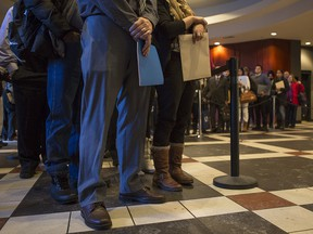 Hundreds of hopeful applicants wait in line at a Calgary jobs fair in 2015.