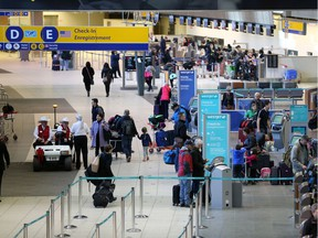 Passengers check in on the departures level at the Calgary International Airport on Monday morning December 17, 2018. The airport is preparing for some of the busiest travel days of the year as Christmas approaches.