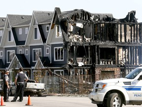 Fire extensively damaged townhomes being built in the Fireside neighbourhood of Cochrane in the early morning of June 6, 2018.