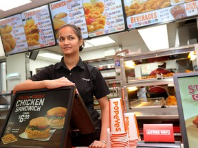Gurjot Kaur, shift manager of Popeyes, is concerned with the rising taxes along  17th Avenue S.W.