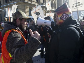 For and against oil protesters discuss their positions during demonstrations in Ottawa, Tuesday February 19, 2019.