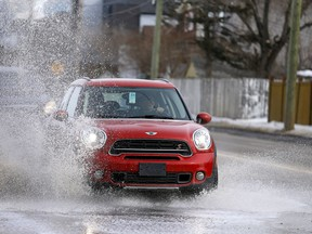 The warmer weather and thaw in Calgary has caused some major puddles along roads like this one on Kensington rd. near Crowchild Trail on Saturday, March 16, 2019.