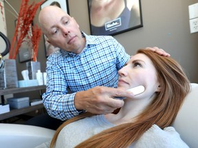 Dr. Robin Scholz performs the Loschn Facial Method using a 6 inch stainless steel surgical tool on patient, Alexandra Robertson at the Westside Chiropractic Sports and Dance Therapy Centre in Calgary for a Lifestye story on Tuesday March 5, 2019. Darren Makowichuk/Postmedia