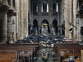 Daylight makes clear the fire damaged wood and stone near the altar inside Notre Dame Cathedral in Paris, France, on Tuesday, April 16, 2019.