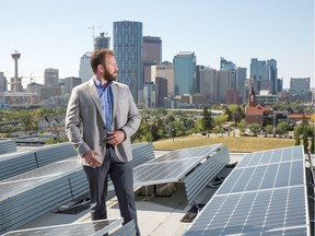 Mike Bucci on the roof of Radius in Bridgeland with solar panels.
