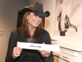 Canadian country music star Terri Clark placed a plaque on the wall to honour her induction into the Country Music Hall of Fame at the National Music Centre in Calgary  in 2019.